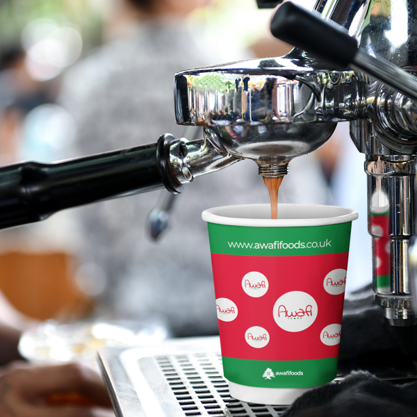 Branded paper cup with coffee being poured